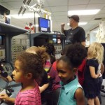 Students at the hands on display shuttle consoles