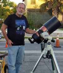 Mark Marquette with his telescope